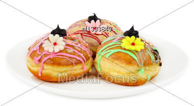 Sufganiyot - Donuts For Hanukkah. With Black Chocolate And Marzipan Flowers Stock Photo
