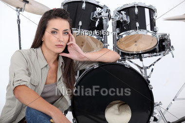 Sultry Female Drummer Stock Photo