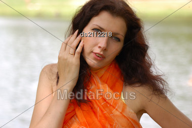 Summer - Beautiful Female Outdoors In The Park In Orange Scarf Stock Photo