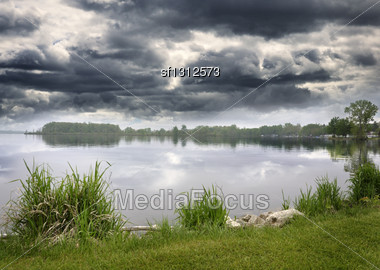 Summer Lake And Sky With Stormy Clouds Stock Photo