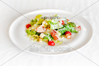 Summer Salad With Shrimps On A White Plate Stock Photo