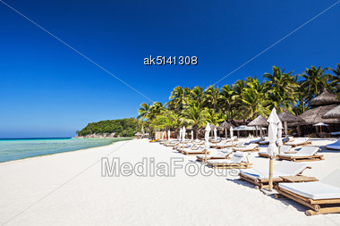 Sun Beds On The Lonely Beach, Boracay Stock Photo