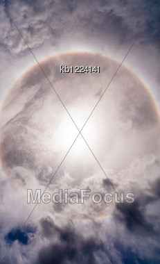 Sun With Circular Rainbow Sun Halo In Sky With Cloud Stock Photo
