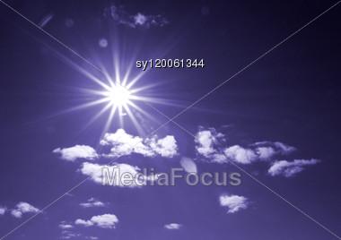 Sun On Cloudy Sky Stock Photo
