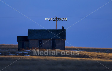 Sun Setting On Old School House Alberta Canada Stock Photo