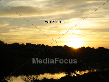 Sunrise Sky With Lighted Clouds Stock Photo