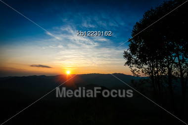 Sunset Behind Mountain In National Park Of Thailand Stock Photo