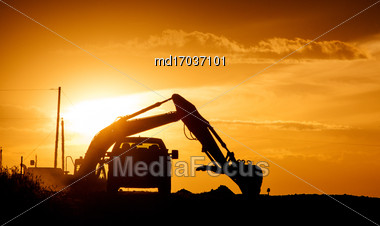 Sunset Construction Loader Orange Sun And Truck Stock Photo