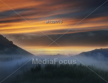 Sunset In The Foggy Mountains Landscape Stock Photo