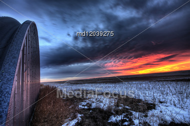 Sunset On Prairie Winter Saskatchewan Canada Scenic Stock Photo