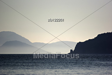 Sunset At Seashore, Graduated Blue Landscape, Misty Islands At Distance. Stock Photo