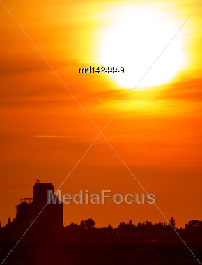 Sunset Sillouette With Grain Elevator And Pense Saskatchewan Stock Photo