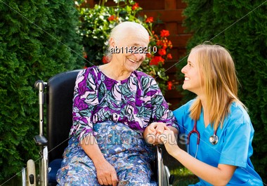 Supporting Hand From Kind Doctor For The Elderly Woman Stock Photo