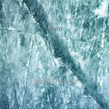 Surface Of Outdoor Ice Rink Replete With Skate Marks. Ice Background Stock Photo