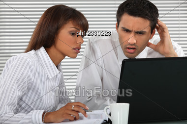 Surprised Businesspeople Stock Photo