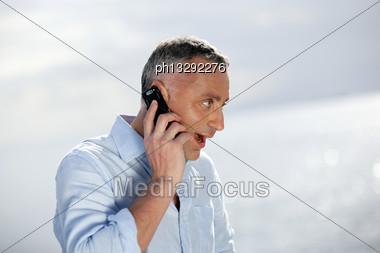 Surprised Man Talking On The Phone Stock Photo
