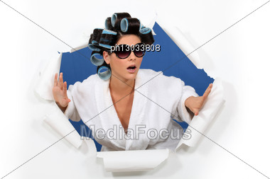 Surprised Woman In Hair Rollers Stock Photo