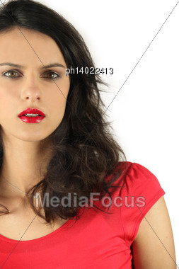 Surprised Woman On Beige Background Stock Photo
