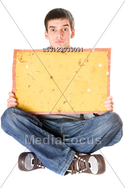 Surprised Young Man Holding Vintage Yellow Board Stock Photo