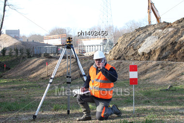 Surveyor Setting Up His Specialized Equipment Stock Photo