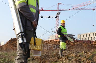 Surveyors On A Construction Site Stock Photo