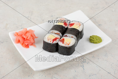 Sushi Rolls Made Of Crab Meat, Cheese, And Tomato Stock Photo