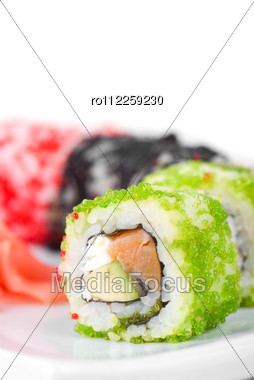 Sushi Rolls Made Of Fish Avocado And Different Flying Fish Roe (tobiko Caviar) Stock Photo