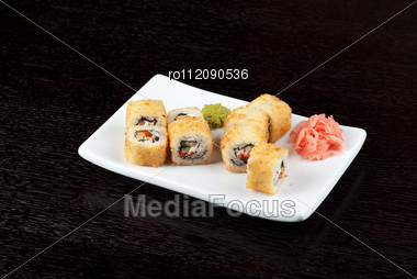 Sushi Rolls Made Of Rice, Smoked Eel, Cream Cheese And Flying Fish Roe - Tobiko Caviar Stock Photo