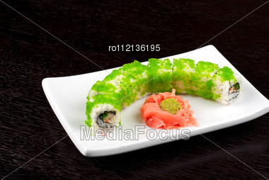 Sushi Rolls Made Of Salmon, Avocado, Flying Fish Roe - Tobiko Caviar And Philadelphia Cheese Stock Photo