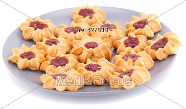 Sweet Cookies With Jam On Gray Plate Isolated On White Background Stock Photo