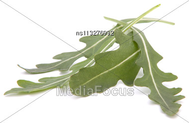 Sweet Rucola Salad Or Rocket Lettuce Leaves Isolated On White Background Stock Photo