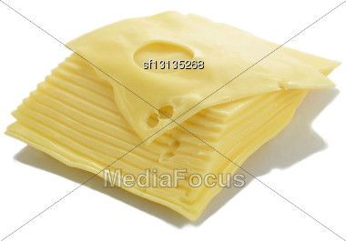 Swiss Cheese Slices On White Background Stock Photo