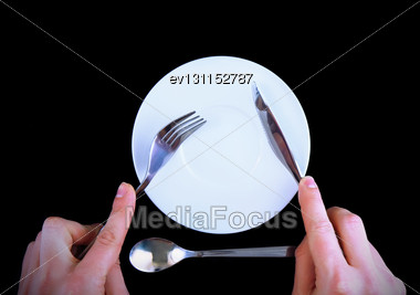 Table Serving-knife, Fork In Hands On Black Background Stock Photo
