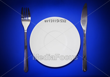 Table Serving-knife,plate,fork On Various Colour Background Stock Photo