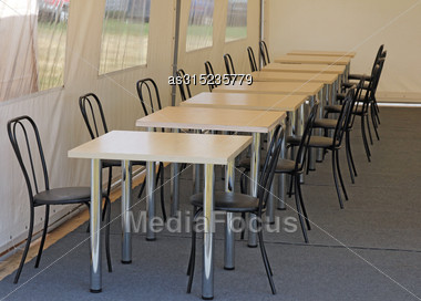 Tables And Chairs In The Dining Room In The Tent Camp Stock Photo