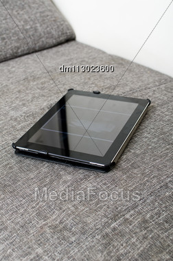 Tablet Computer Laying On The Sofa Stock Photo