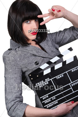 Take Two: Girl With A Film Clapperboard Stock Photo