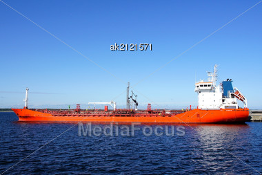 Tanker Is Moored In The Port And Loaded Fuel Stock Photo