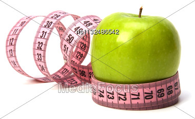 Tape Measure Wrapped Around The Apple Isolated On White Background Stock Photo