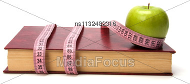 Tape Measure Wrapped Around Book Isolated On White Background Stock Photo