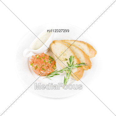 Tar-tar From Salmon Fish With Green Onion. Served With Honey Sauce And White Bread Toast. Stock Photo