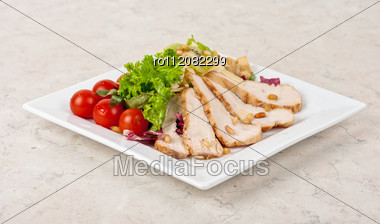 Tasty Appetizer Of Meat, Cherry Tomato, Greens And Groundnut Stock Photo