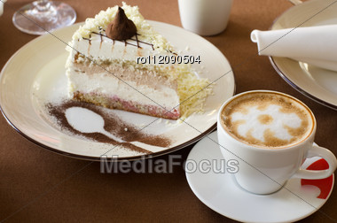 Tasty Cake At Plate Closeup With Coffee Cup Stock Photo