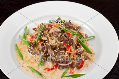Tasty Dish Of Sliced Beef Roasted With Vegetables Stock Photo
