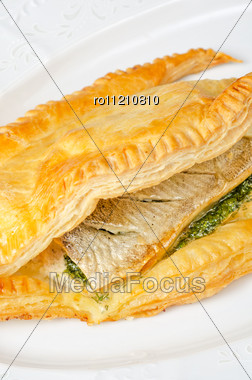 Tasty Dish Of Trout Fish Baked With Greens At Dough Stock Photo
