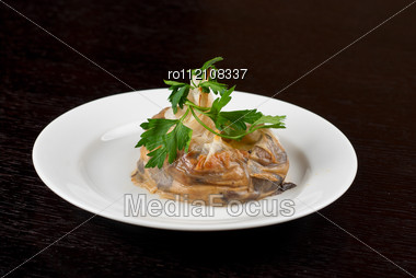 Tasty Mushroom Mix With Cheese And Cream Wrapped At Rice Paper Packet Stock Photo