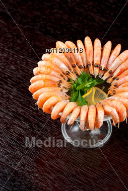 Tasty Shrimps With Lemon And Greens Closeup Stock Photo