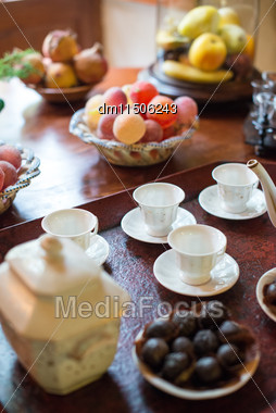 Tea, Cups And Sweets On The Table Stock Photo