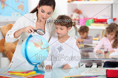 Teacher, Pupil, Reading, Globe Stock Photo