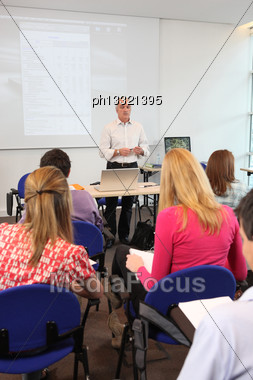 Teacher Stood At Front Of Class Room Stock Photo